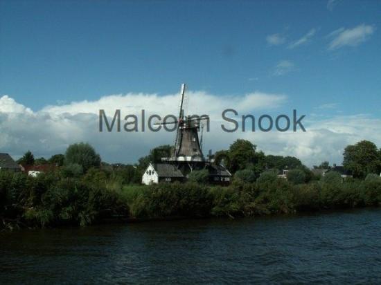 Windmill On Dutch Canal
