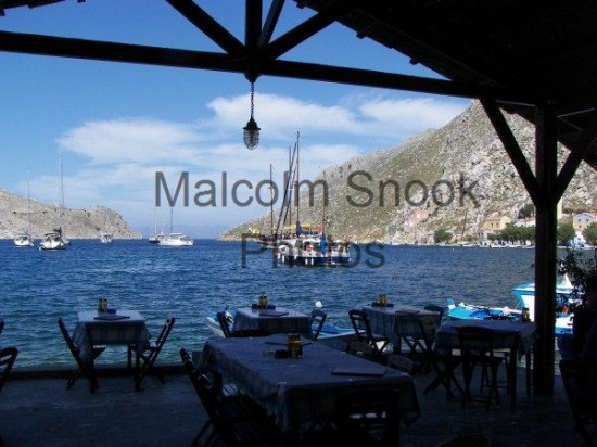 Yachts Anchored Outside Restaurant Symi